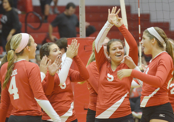 WARREN DILLAWAY / Star Beacon<br /> MEMBERS OF the Geneva volleyball team celebrate after clinching a PAC title with a home win over Eastlake North on Thursday night. (From left) Megan Cool, Allie Penna, Kylee Corlew and Sara Juncker were all smiles after winning the match in three straight games.
