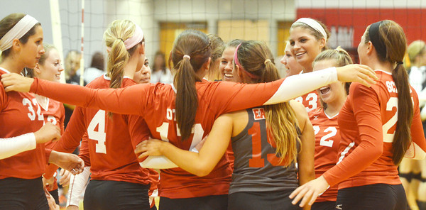 WARREN DILLAWAY / Star Beacon<br /> MEMBERS OF the Geneva volleyball team celebrate after clinching a PAC title with a home win over Eastlake North on Thursday night.