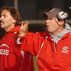WARREN DILLAWAY / Star Beacon<br /> DON SHYMSKE, assistant Geneva football coach, (right) signals to his team Thursday night as head coach Tony Hassett looks on during the Homecoming game with Madison at Spire Institute in Harpersfield Township.