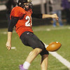 WARREN DILLAWAY / Star Beacon<br /> BRANDON BALASCIO of Jefferson punts Friday evening during a home game with Champion.