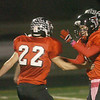 WARREN DILLAWAY / Star Beacon<br /> BRETT POWERS (right) receives congratulations from Jefferson teammate Justin Butler after a touchdown Friday night during a home game with Champion.