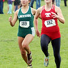 WARREN DILLAWAY / Star Beacon<br /> EMILY DEERING (right) of Geneva sprints to the finish line with Lakeside's Karen Barrientos Friday during the Premier Athletic Conference Cross Country Meet at the Perry Outdoor YMCA.