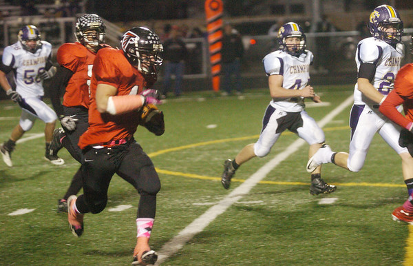 WARREN DILLAWAY / Star Beacon<br /> SCOTT DAVIDSON (left with ball) rambles for a touchdown Friday night during a home game with Champion.