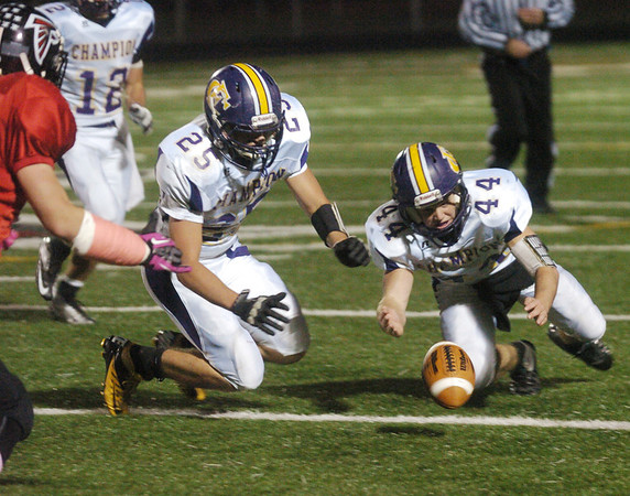 WARREN DILLAWAY / Star Beacon<br /> JACOB RASEY (44) of Champion prepares to recover a Jefferson fumble with teammate Rocco Sandrella as Jefferson Scott Davidson (far left) enters the picture and Golden Flash Mike Cyrus follows the play Friday night at Falcon Stadium.