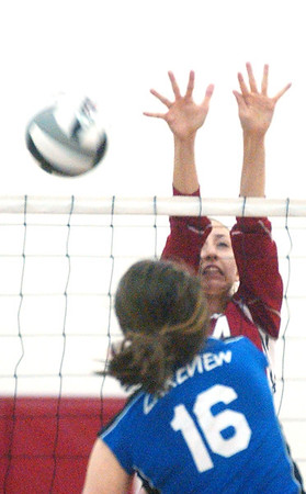 WARREN DILLAWAY / Star Beacon<br /> KATIE THOMAS (facing) of Edgewood leaps for a block of a spike by Cortland's Marissa Naples (16) Monday evening during a Division II District game at Jefferson.