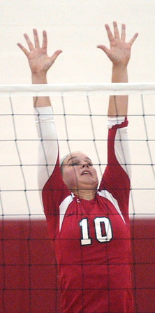 WARREN DILLAWAY / Star Beacon<br /> SANDY ELLY (10) of Perry leaps for a block Monday evening during a Division II Sectional match with Conneaut at Jefferson.