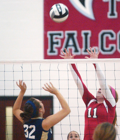 WARREN DILLAWAY / Star Beacon<br /> BETHANY MAKO (11) of Perry hits the ball towards Conneaut's Megan Tessmer Monday evening during Division II Sectional action at Jefferson.