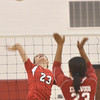 WARREN DILLAWAY / Star Beacon<br /> IESHA NICIU (back to camera) of Edgewood prepares to jump as Maddie DiBease of Perry prepares to spike on Tuesday evening during a Division II semifinal at Jefferson.