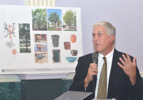 WARREN DILLAWAY / Star Beacon<br /> JOHN MCKNIGHT, owner of McKnight Associates Ltd., presents ideas relating to a potential changes in the look o downtown Ashtabula. He addressed an open forum at Casa Capelli's on Tuesday evening.