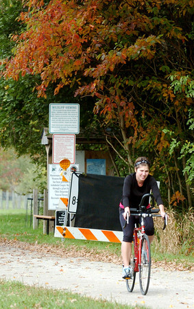 WARREN DILLAWAY / Star Beacon<br /> TICEY CZUP  completes a bicycle ride along the Greenway Trail near Route 307 in Austinburg Township.