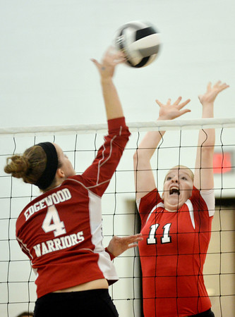 WARREN DILLAWAY / Star Beacon<br /> BETHANY MAKO (11) of Perry leaps for a block of a spike by Alyssa Johnson (4) of Edgewood on Tuesday night during a Division II sectional semifinal at Jefferson.