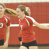 WARREN DILLAWAY / Star Beacon<br /> GRACE MCGARRY (7) and Perry teammate Maddie DiBease celebrate after a point on Tuesday night during a Division II sectional semifinal at Jefferson.