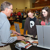 WARREN DILLAWAY / Star Beacon<br /> TONY INDOVINA, a representative of Arcadia University, chats with Jefferson HIgh School seniors Brady Olsen (left) and Allison Simon during a college fair on Tuesday evening at Kent State University-Ashtabula Campus.