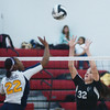 WARREN DILLAWAY / Star Beacon<br /> LEE ANN FARR (32) of Jefferson reaches to block a spike by Streetsboro's Paige Saunders (22) Tuesday evening at Jefferson during Division II Sectional action.
