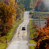 WARREN DILLAWAY / Star Beacon<br /> FALL FOLIAGE highlights both sides of Dorman Road in Conneaut Tuesday afternoon.