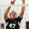 WARREN DILLAWAY / Star Beacon<br /> ARIANN BARILE of Jefferson blocks the ball Tuesday during Division II sectional action against Streetsboro at Jefferson.