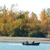 WARREN DILLAWAY / Star Beacon<br /> BOATERS HEAD to Lake Erie from the Conneaut Public Dock in front of trees with brightly colored leaves Tuesday afternoon.
