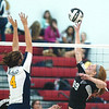 WARREN DILLAWAY / Star Beacon<br /> HAYLEY ALLEN (99) of Jefferson hits the ball as Streetsboro's Lexi Brewster leaps for the block Tuesday night during Division II sectional action at Jefferson.