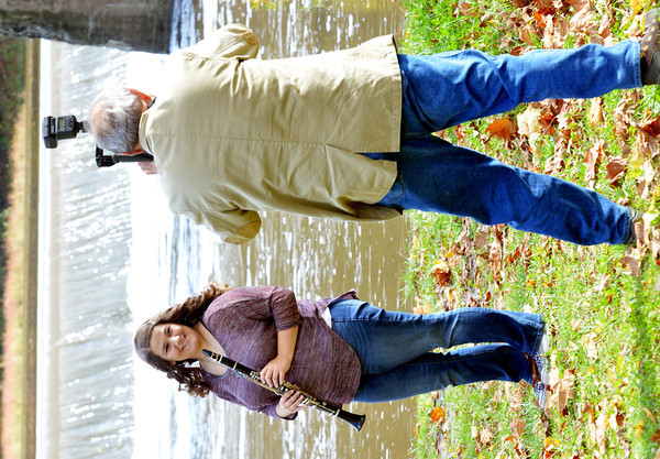WARREN DILLAWAY / Star Beacon<br /> CAYLA CONRAD has her senor picture  taken by Gary Cartner near the Harpersfield Covered Bridge on Friday afternoon.