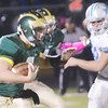 WARREN DILLAWAY / Star Beacon<br /> TYLER LOFTUS (7) of Lakeside tries to find running room as Willoughby South defenderAndrew Gibson (53) closes in on Friday night at Lakeside.