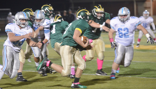WARREN DILLAWAY / Star Beacon<br /> TYLER LOFTUS (7) of Lakeside tries to find running room as Willoughby South defenders Andrew Gibson (53) and Vince Rosa (62)  converge on Friday night at Lakeside.
