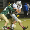 WARREN DILLAWAY / Star Beacon<br /> SHAWN MACKEY of Willoughby South drags Vincent Smith (44) of Lakeside on Friday night at Lakeside.