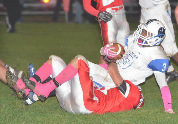 WARREN DILLAWAY / Star Beacon<br /> ANTHONY BARGAR (on ground) of Edgewood tackles Rodell Golphn of Gilmour Academy on Friday night at Corlew Stadium in Ashtabula Township.