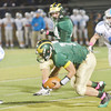 WARREN DILLAWAY / Star Beacon<br /> TYLER LOFTUS (7) of Lakeside grabs a fumble and tries to find running rooms as Willoughby South defenders Tony Lyon (51), Geoffrey Swift (58) and Miles Kovach (18) race for the hit on Friday night at Lakeside.