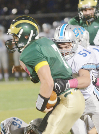 WARREN DILLAWAY / Star Beacon<br /> TYLER LOFTUS (7) of Lakeside is wrapped up by Tony Lyon (51) of Willoughby South on Friday night at Lakeside.