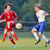 WARREN DILLAWAY / Star Beacon<br /> TYLER HUNT (10) of Geneva and Ryley Baker of Madison dash for the ball on Thursday during a match at Madison.