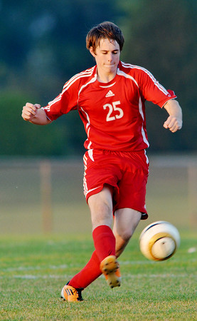 WARREN DILLAWAY / Star Beacon<br /> MATT SEEDS  of Geneva dashes for the ball  on Tuesday evening during a match at Madison..