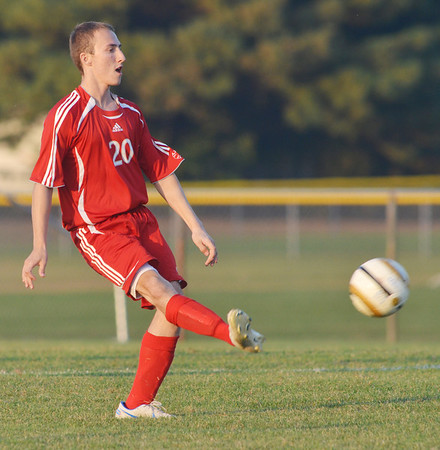 WARREN DILLAWAY / Star Beacon<br /> CHAD WEISBARTH of Geneva  kicks the ball during a match at Madison on Tuesday evening.