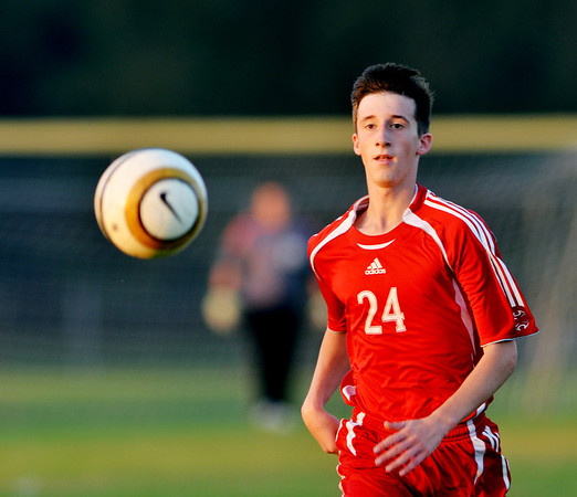 WARREN DILLAWAY / Star Beacon<br /> TYLER HOBEL (24) of Geneva dashes for the ball  on Tuesday evening during a match at Madison..