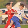 WARREN DILLAWAY / Star Beacon<br /> MICHAEL ANKROM (8) of Geneva battles for the ball with A.J. Dietrich of Madison on Tuesday evening at Madison.