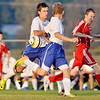 WARREN DILLAWAY / Star Beacon<br /> THE SOCCER ball seems to be chasing (from left) Peter Otterman and Ryley Baker, both of Madison, and Chad Weisbarth of Geneva on Tuesday night at Madison.
