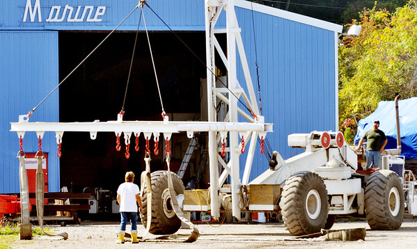 WARREN DILLAWAY / Star Beacon<br /> BOAT REMOVAL equipment is prepared for use at Sutherland Marine in Ashtabula.