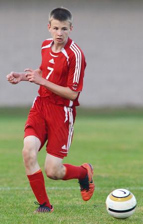 WARREN DILLAWAY / Star Beacon<br /> DAVID REPKO (7) of Geneva kicks the ball y on Tuesday evening at Madison.
