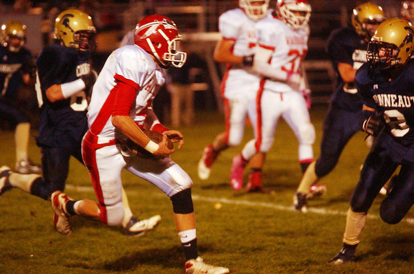 WARREN DILLAWAY / Star Beacon<br /> EDGEWOOD QUARTERBACK Louie Wisnyai (left holding ball) works for an extra yard  with Conneaut defender Tyler Cox closing in Friday evening in Conneau.t