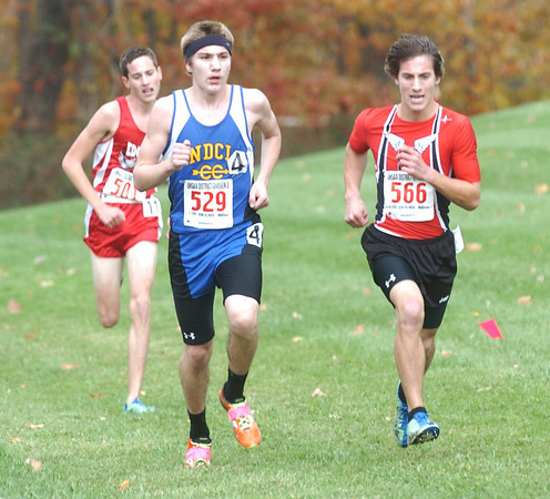 WARREN DILLAWAY / Star Beacon<br /> AARAN GESSIC (566) of Perry, Michael Beebee of Notre Dame Cathedral Latin (529) and Edgewood's Chris Lemay battle it out at the front of the Division II District Cross Country Meet Saturday at Lakeland Community College.