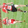 WARREN DILLAWAY / Star Beacon<br /> GILBERT DESIN of Perry and Derryn Tomsic of Edgewood race to the finish line Saturday during the Division II District Cross Country Meet at Lakeland Community College.