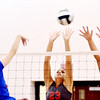 WARREN DILLAWAY / Star Beacon<br /> SARA JUCKER (23) and Geneva teammate Chelsea Scafuro (27) leap to block a spike by Stephainie Williams of Notre Dame Cathedral Latin during a Division II District semifinal at Jefferson on Tuesday evening.