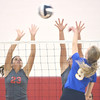 WARREN DILLAWAY / Star Beacon<br /> SARAH JUNCKER (23) and Emily Ball (face hidden) of Geneva leap for a block of a spike by Emily Suppel of Notre Dame Cathedral Latin on Tuesday night during a Division II District semifinal at Jefferson.