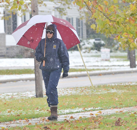 WARREN DILLAWAY / Star Beacon<br /> KIM MARCY of Pierpont Township enjoys a walk in the snow during a break from work in Jefferson.