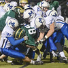 WARREN DILLAWAY / Star Beacon<br /> A HOST of Madison tacklers brind down Demetrius Green of Lakeside on Friday night at Lakeside.
