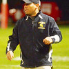 WARREN DILLAWAY / Star Beacon<br /> ROCCO DURBAN, Conneaut football coach, instructs his team on Friday night at Edgewood.