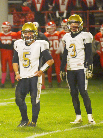 WARREN DILLAWAY / Star Beacon<br /> TROY COLUCCI, Conneaut quarterback, (left) and C.J. Rice look for signals from the sideline on Friday night  at Edgewood.