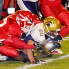 WARREN DILLAWAY / Star Beacon<br /> R.J. NELSON (20) of Conneautu reaches for an extra yard while an Edgewood defender holds on to him on Friday night at Edgewood.