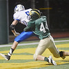 WARREN DILLAWAY / Star Beacon<br /> BRANDON DAVIS of Madison (5) drags Vincent Smith of Lakeside into the end zone for a touchdown on Friday night at Lakeside.