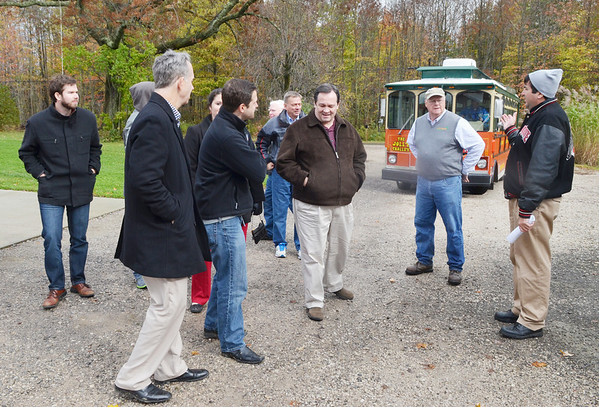 WARREN DILLAWAY / Star Beacon<br /> JON GRISWOLD, chief executive officer of Aloterra Energy in Monroe Township, (second from right) greets State Representative David Hall of Holmes County and other members during an agricultural committee tour of Ashtabula County.