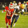 WARREN DILLAWAY / Star Beacon<br /> C.J. RICE of Conneaut prepares to make a diving catch in front of Mason Lilja of Edgewood on Friday night at Edgewood.